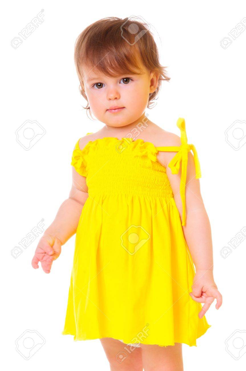 Cute Little Girl In A Yellow Dress Portrait Of A Close-up In ...