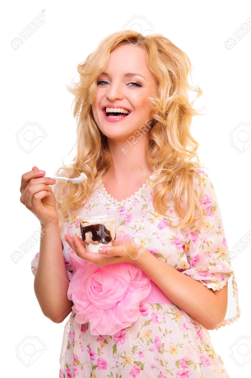 Beautiful young woman eating ice cream and holding a spoon in her hand  portrait isolated on white background  positively laughs Stock Photo - 14157178