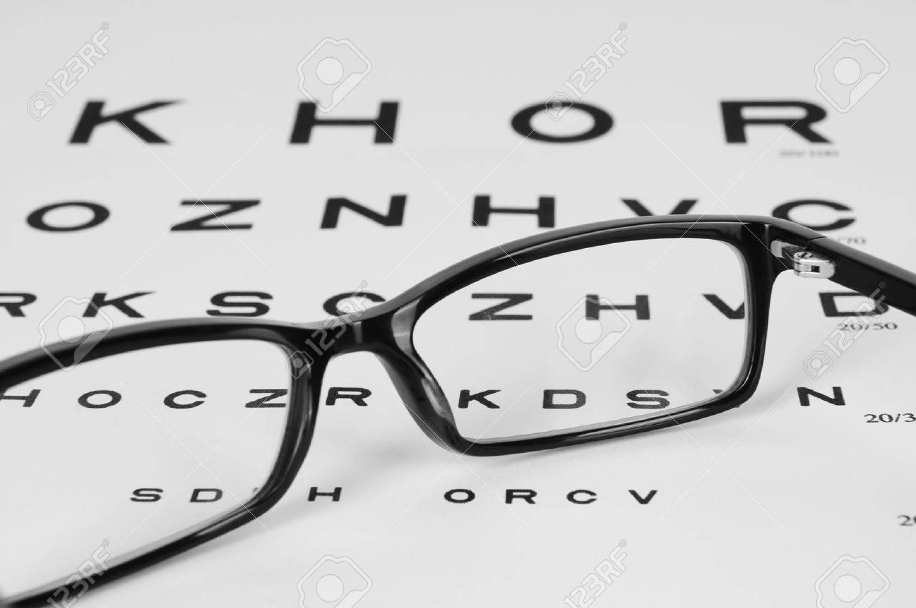 Reading eyeglasses and eye chart close up on a light gray reading eyeglasses and eye chart close up on a light gray background stock photo nvjuhfo Image collections