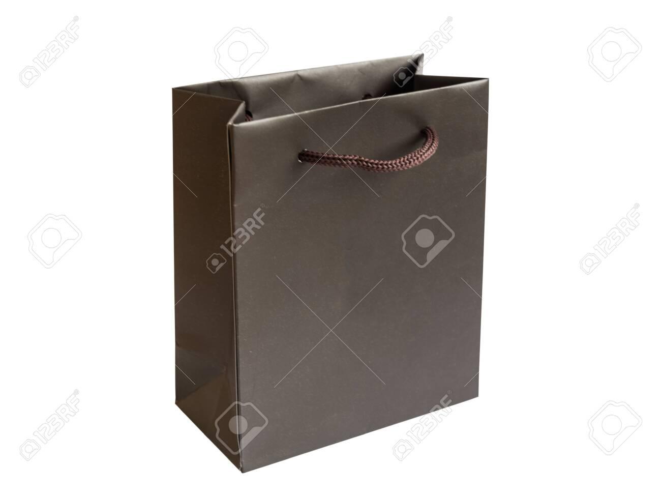 Blank paper gift bag isolated on white background. Shopping bag. Mockup for design. - 147420131