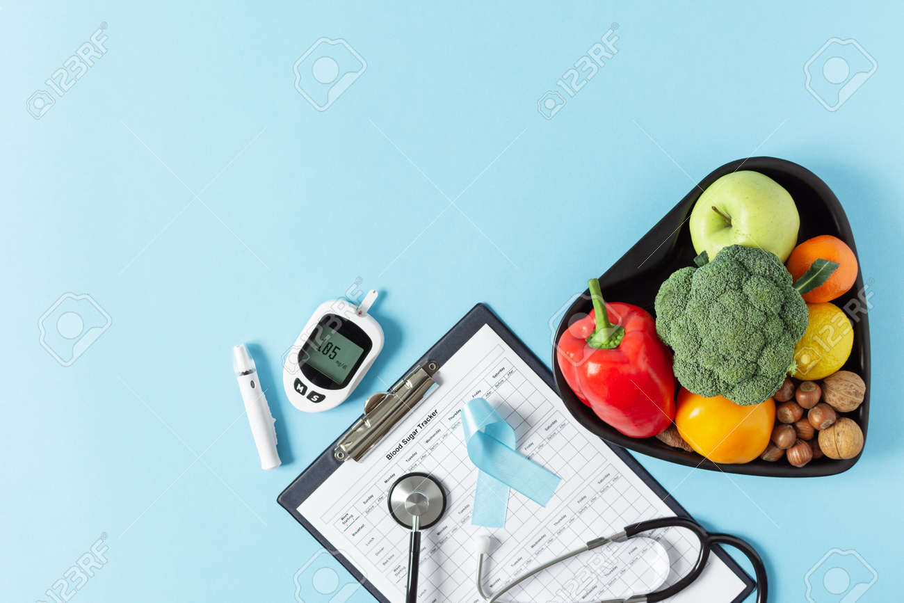 Fresh vegetables and fruit with glucometer top view on blue background. Diabetic dieting concept. - 162813140