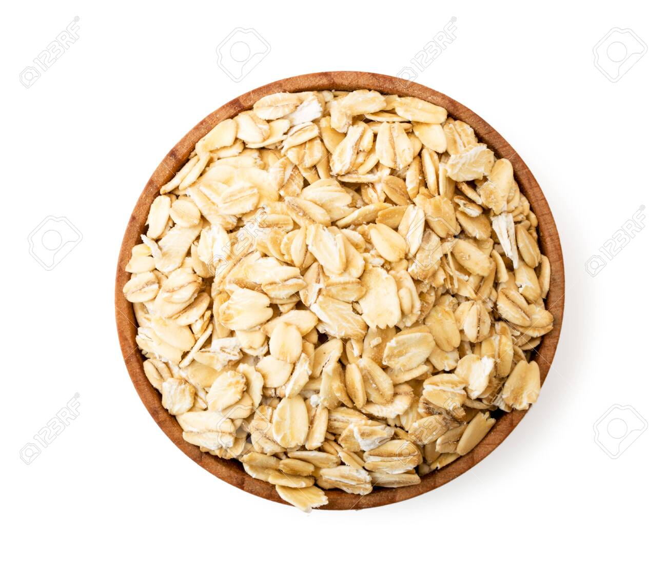 Oatmeal in a wooden plate on a white background. - 126433627