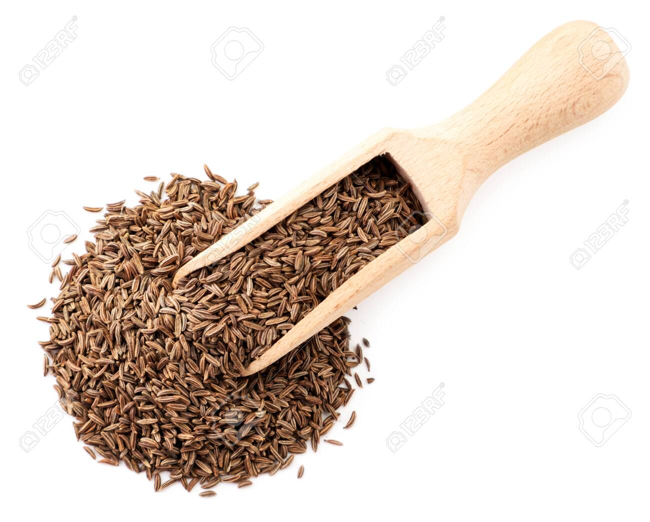Cumin seeds in a wooden spoon on a white. The view from top - 144902914