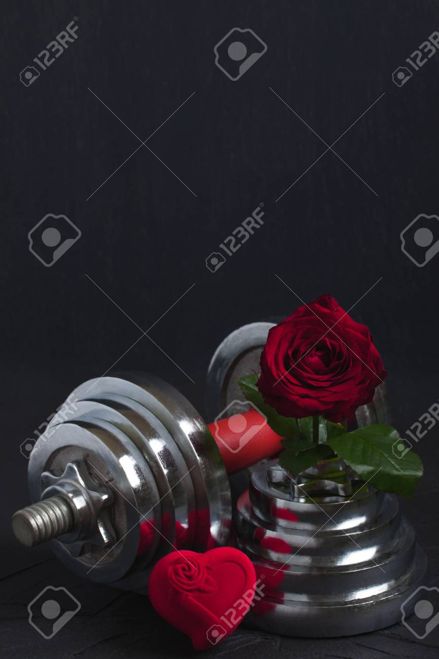 7eb8207615f4c Stock Photo - Valentines sports background with heavy dumbbell for workout