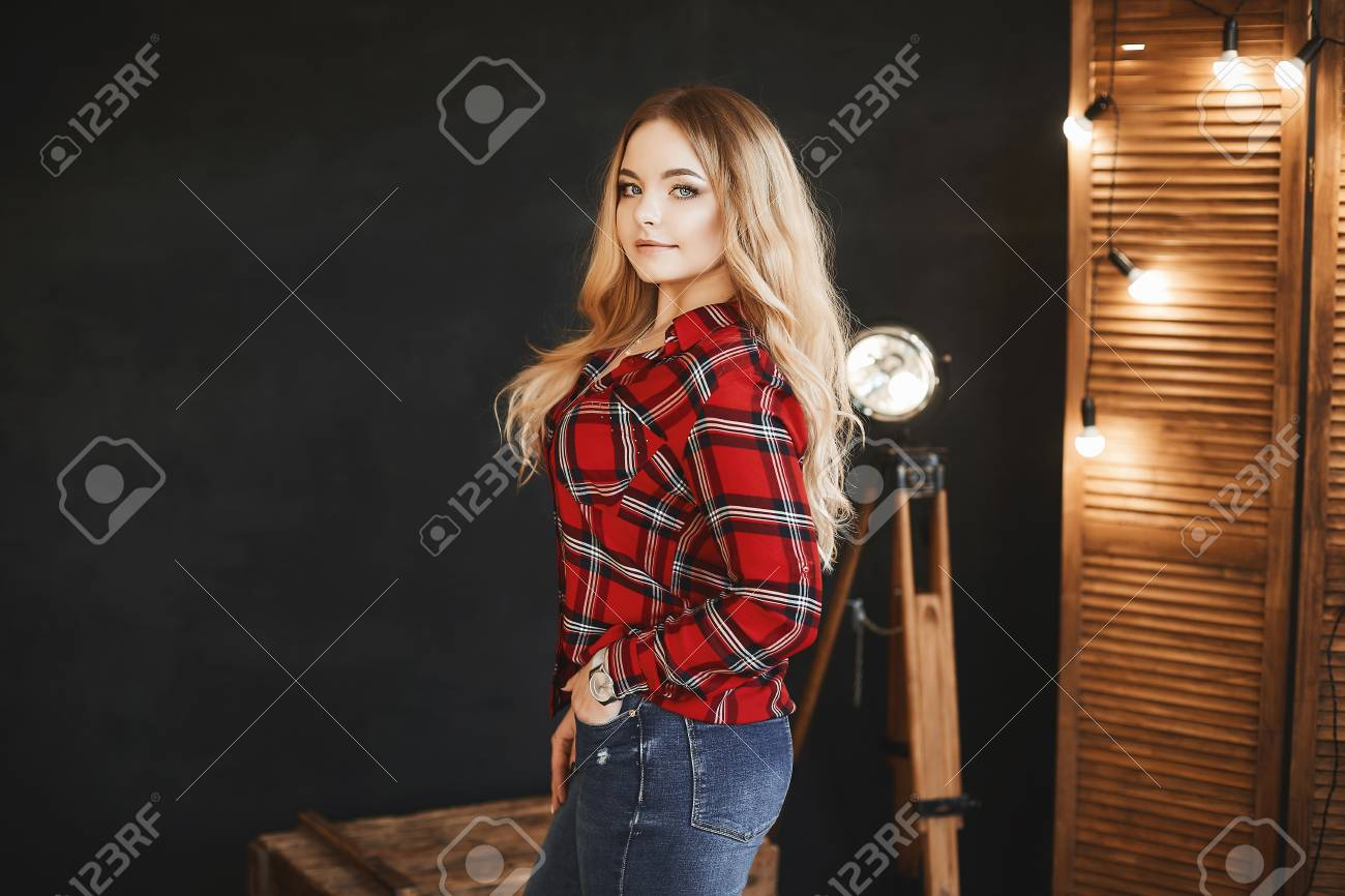 1cc977f35ad61e Beautiful and fashionable blonde pluss-size model girl with big breast in red  plaid shirt