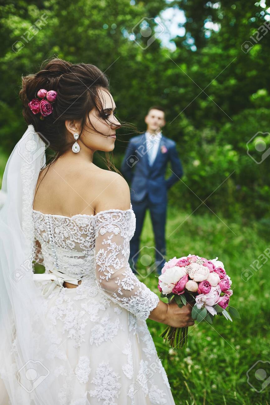 Beautiful plus size model woman with wedding hairstyle in a fashionable..