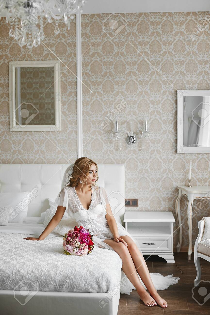 Sexy Young Bride In Lace Peignoir Leggy Beauty With Blond Hair Stock Photo Picture And Royalty Free Image Image 130357458