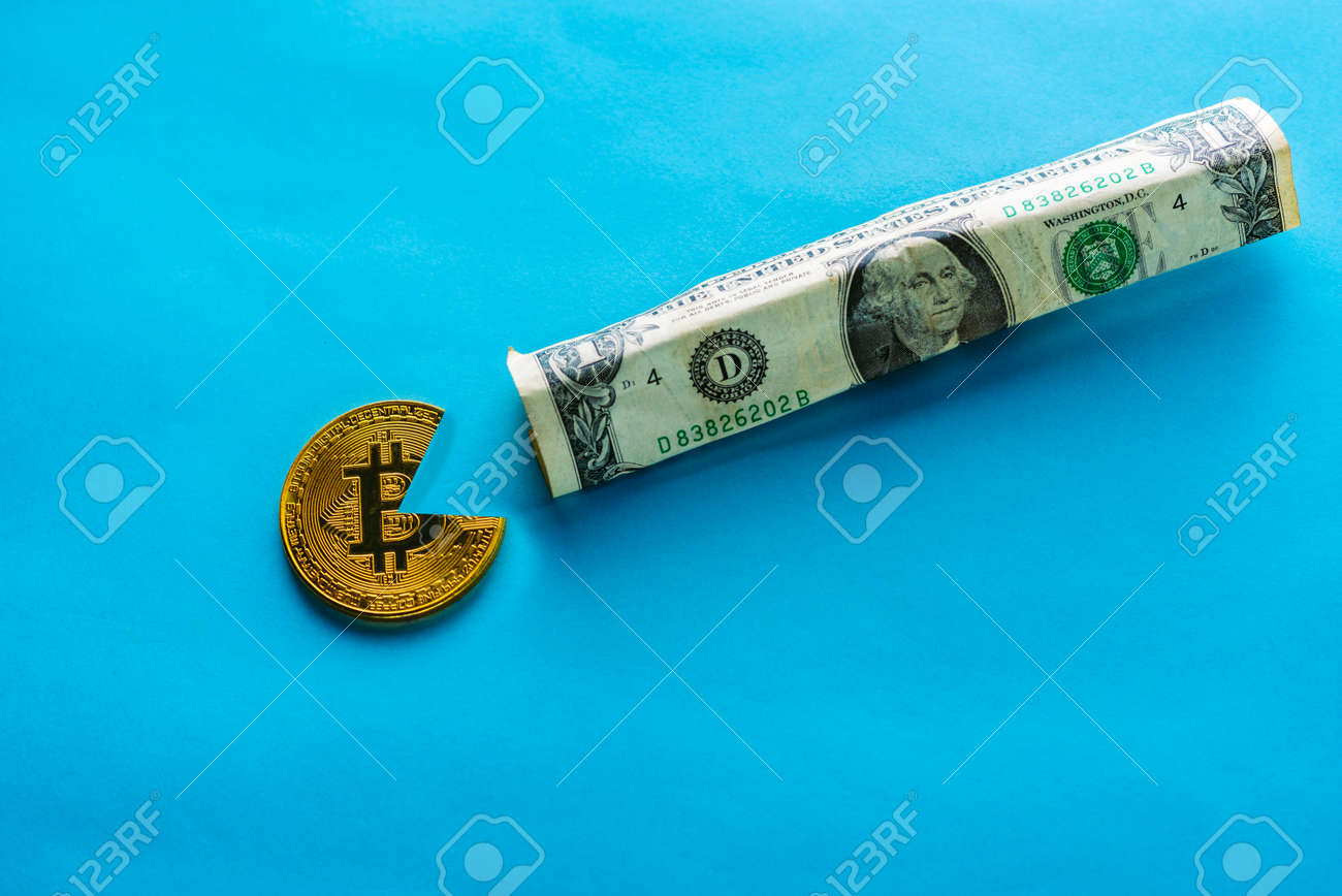 Bitcoin eating dollar. For articles or publications : Bitcoin vs USD dollar, Is Strong, Stable and Better Than Gold and other currencies. Copy space for text. - 127603217