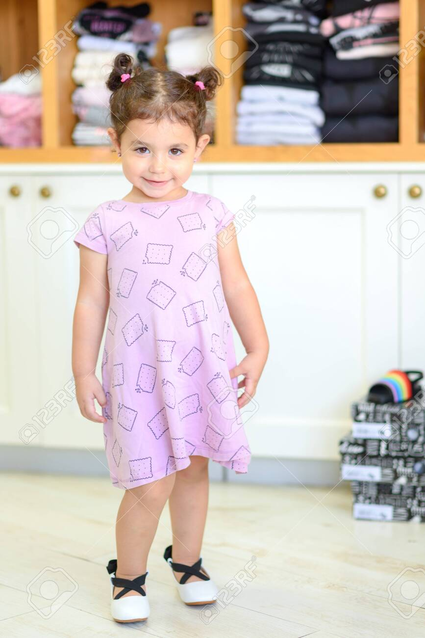 Cute Little Girl In A Shoe And Clothes