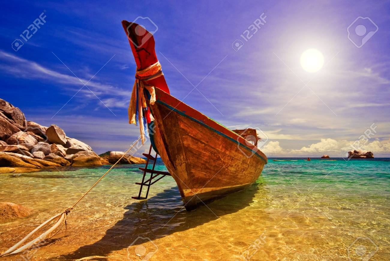 Traditional Thai Longtail Boat at Sunset Stock Photo - 5400084