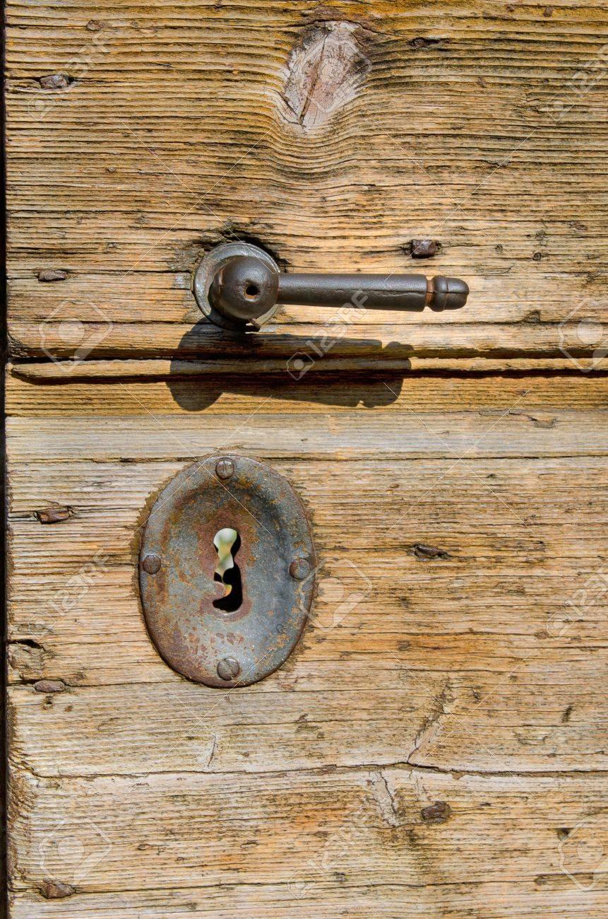 Old Wooden Door With Rusty Metal Handle And Key Lock Stock Photo ...