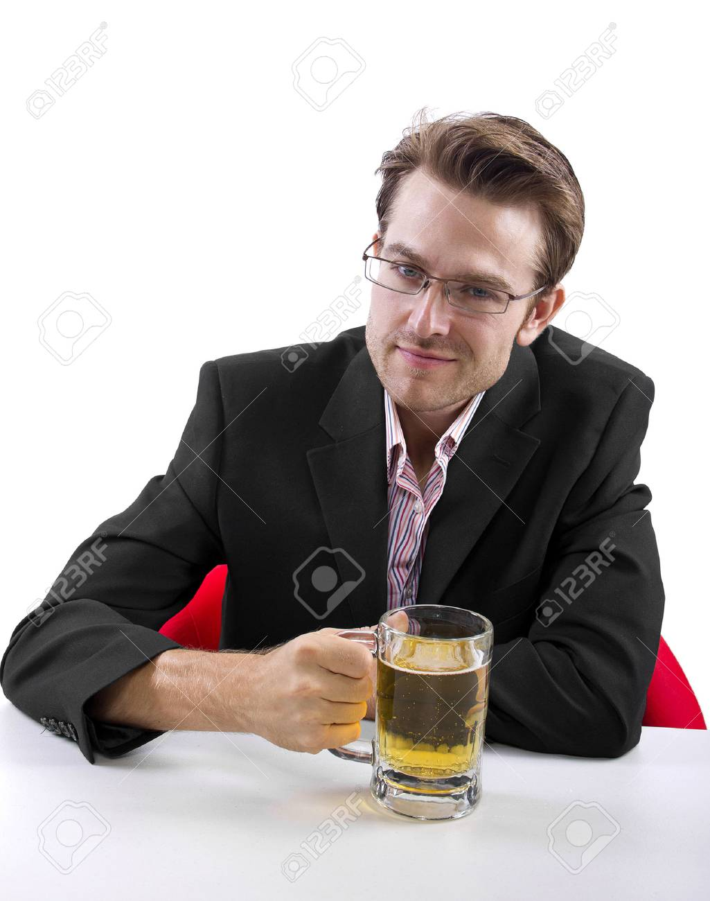 Businessman drinking beer on a white countertop Stock Photo - 25160424