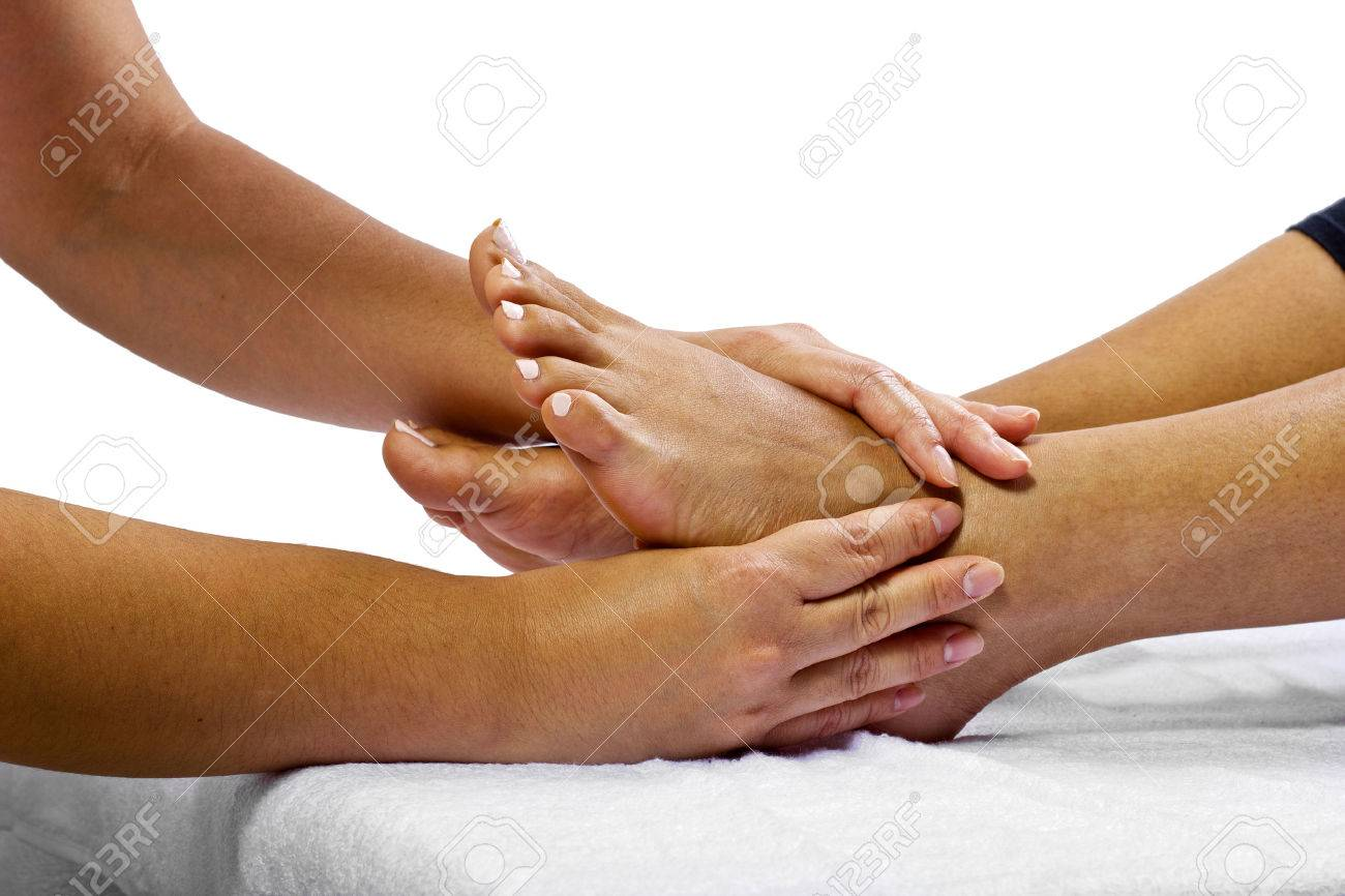 close up of masseuse massaging client's foot Stock Photo - 25282850