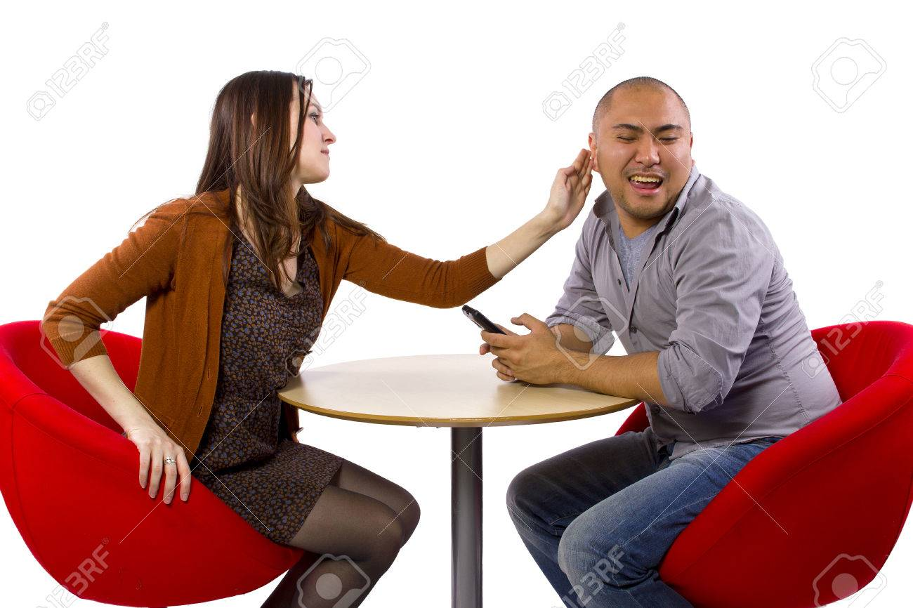 rude interracial couple on a bad date Stock Photo - 27491928