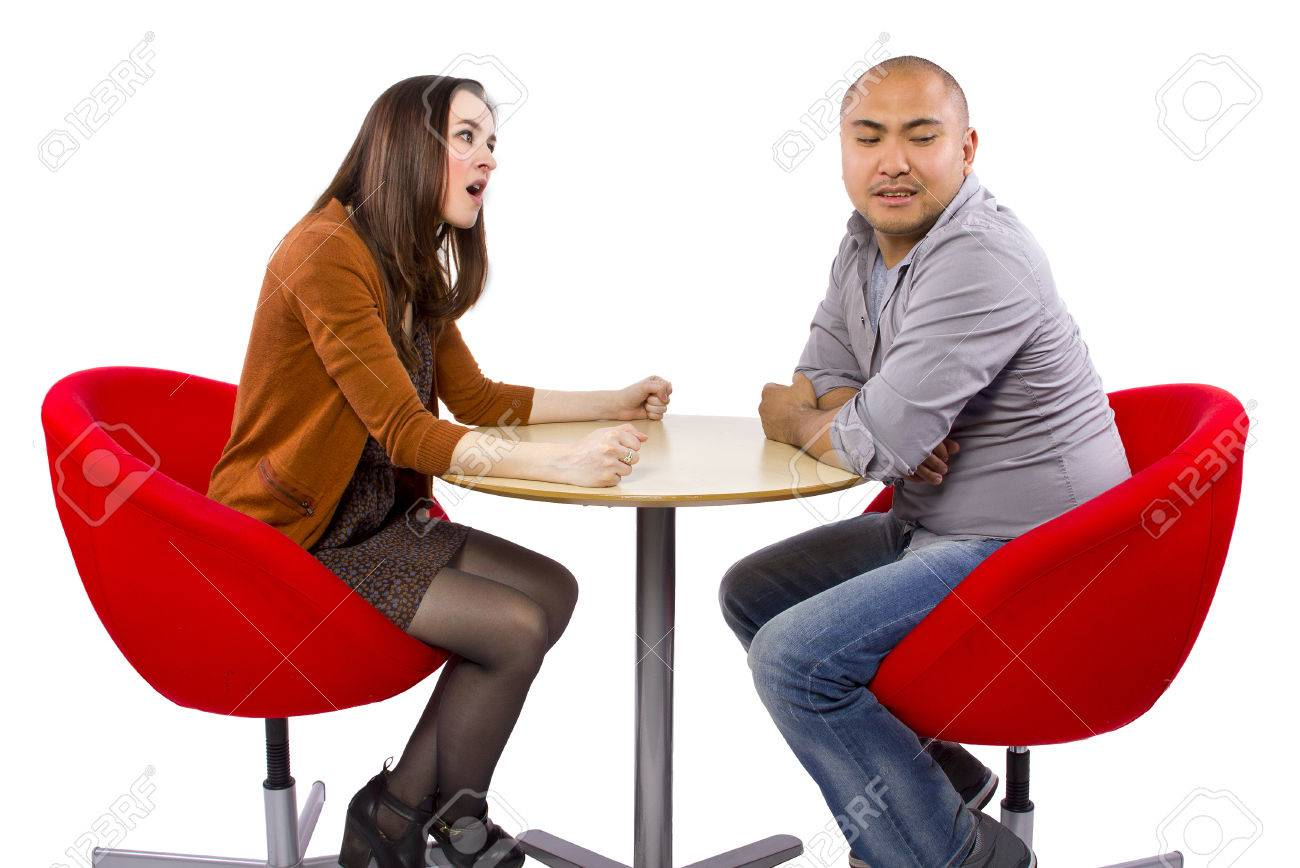 rude interracial couple on a bad date Stock Photo - 27491936