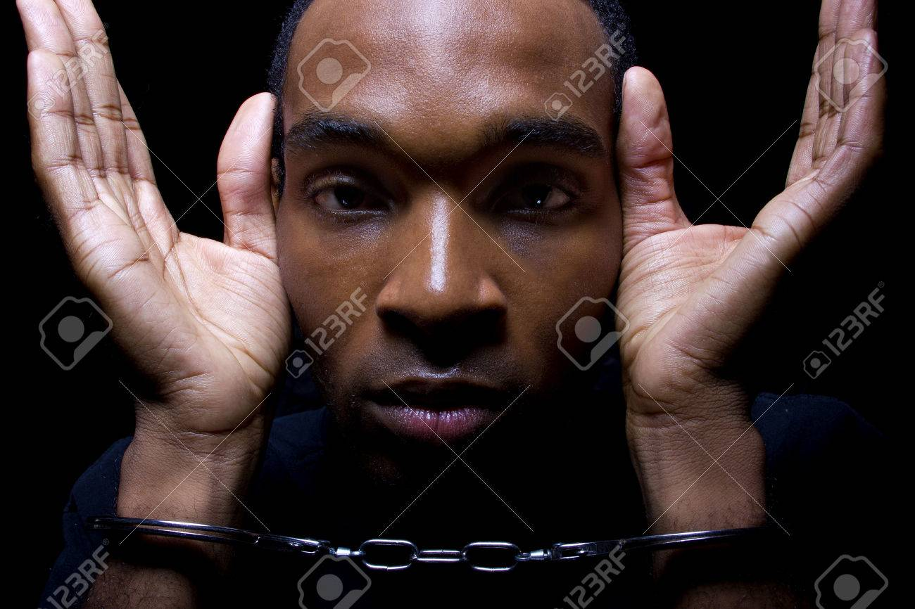 close up portrait of hand cuffed black man stock photo picture and royalty free image image 31088943