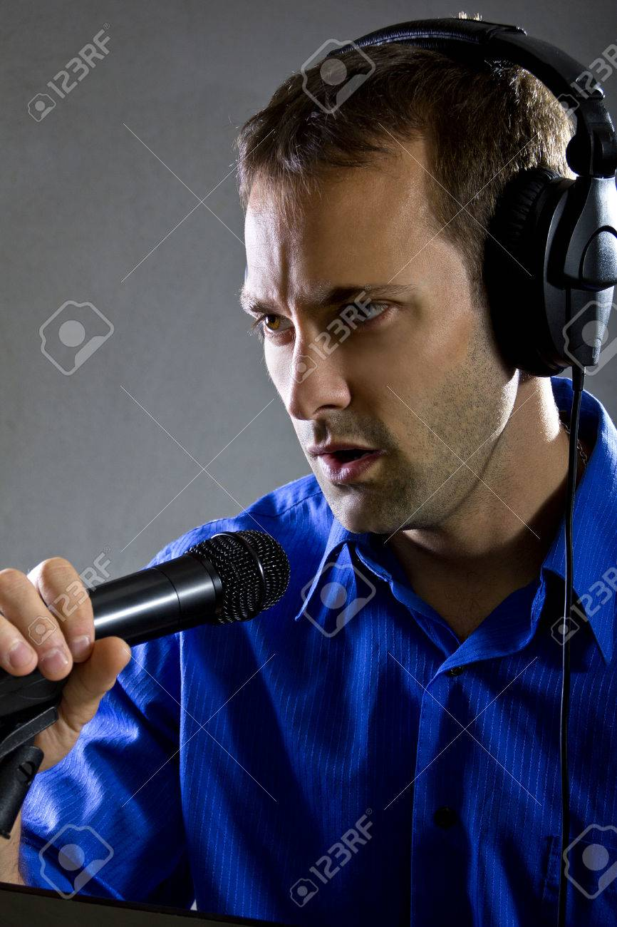 male voice over artist or singer on a microphone wearing a blue