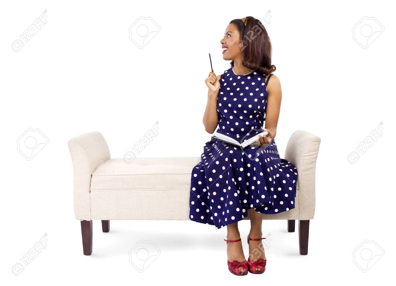 Vintage Style Black Female Author Writing And Sitting On A Chaise