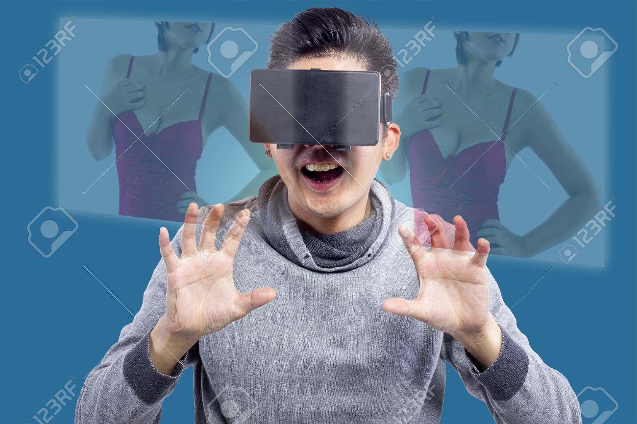 male watching 3d virtual reality porno movie with headset stock