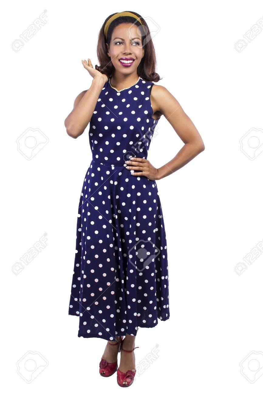 dac863c801 Black female wearing a blue vintage polka dot dress on a white background  Stock Photo -