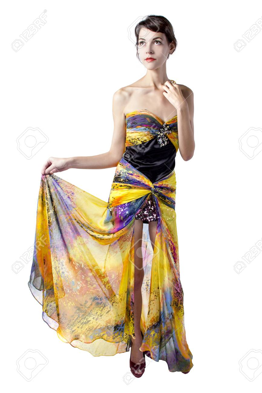 4b0f3b05 Young female wearing a fashionable yellow silk tie dye dress Stock Photo -  47685439