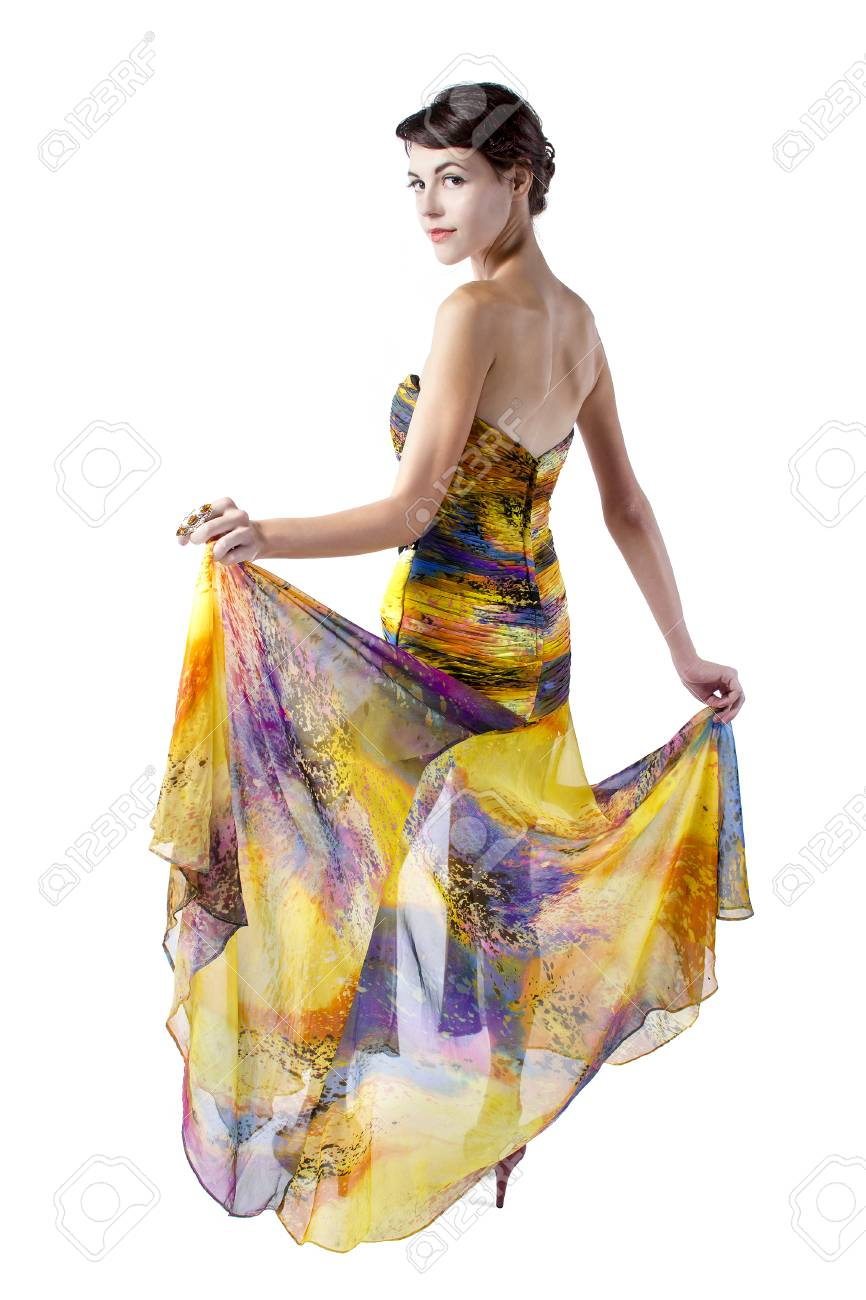 3989e902 Young female wearing a fashionable yellow silk tie dye dress Stock Photo -  47685582