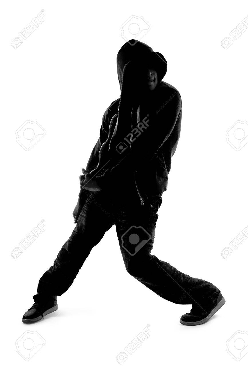 Black And White Silhouette Of A Male Dancer Posing With Dance Moves Stock Photo