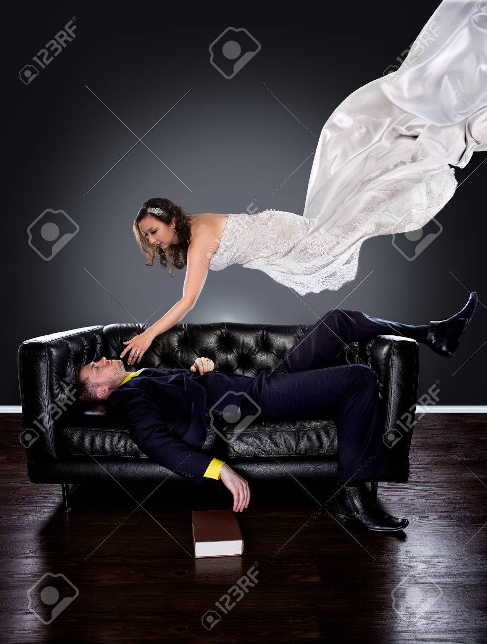 Man Dreaming On A Couch Of A Girl In A Wedding Dress Floating