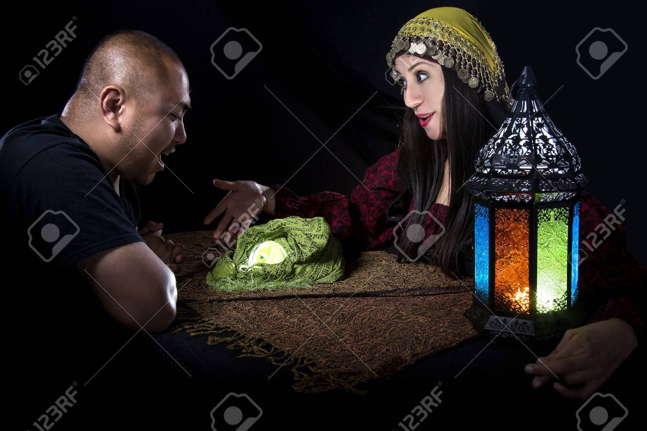 Gullible patron with scam artist or fraudulent psychic fortune
