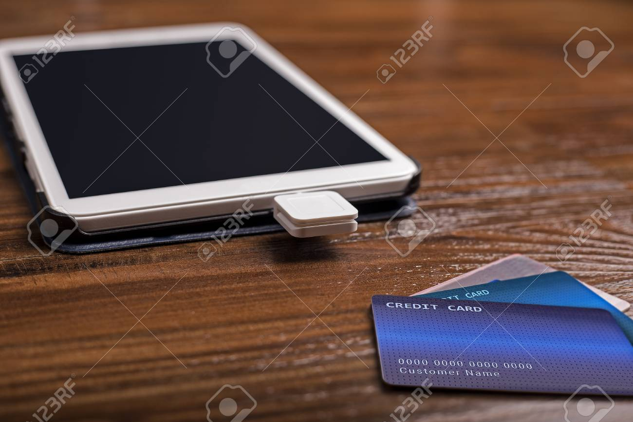 Credit card payment on a swipe or chip reader app on a tablet credit card payment on a swipe or chip reader app on a tablet used by small colourmoves