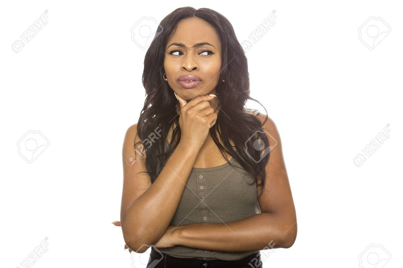 Black female isolated on a white background displaying facial confused expressions. She is young and of African American ethnicity. - 85349669