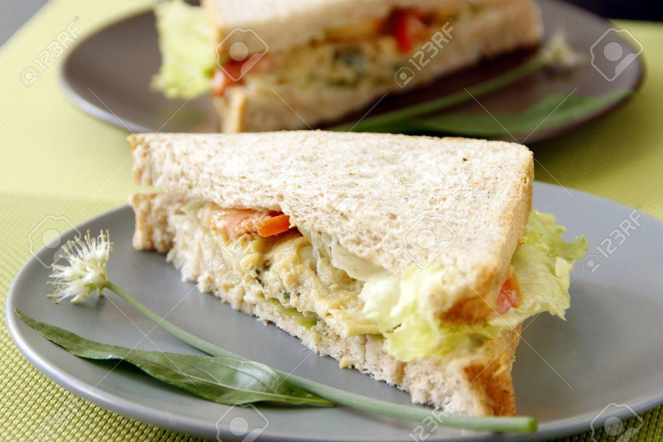 Egg sandwich garnish with herbs and vegetables Stock Photo - 22110159