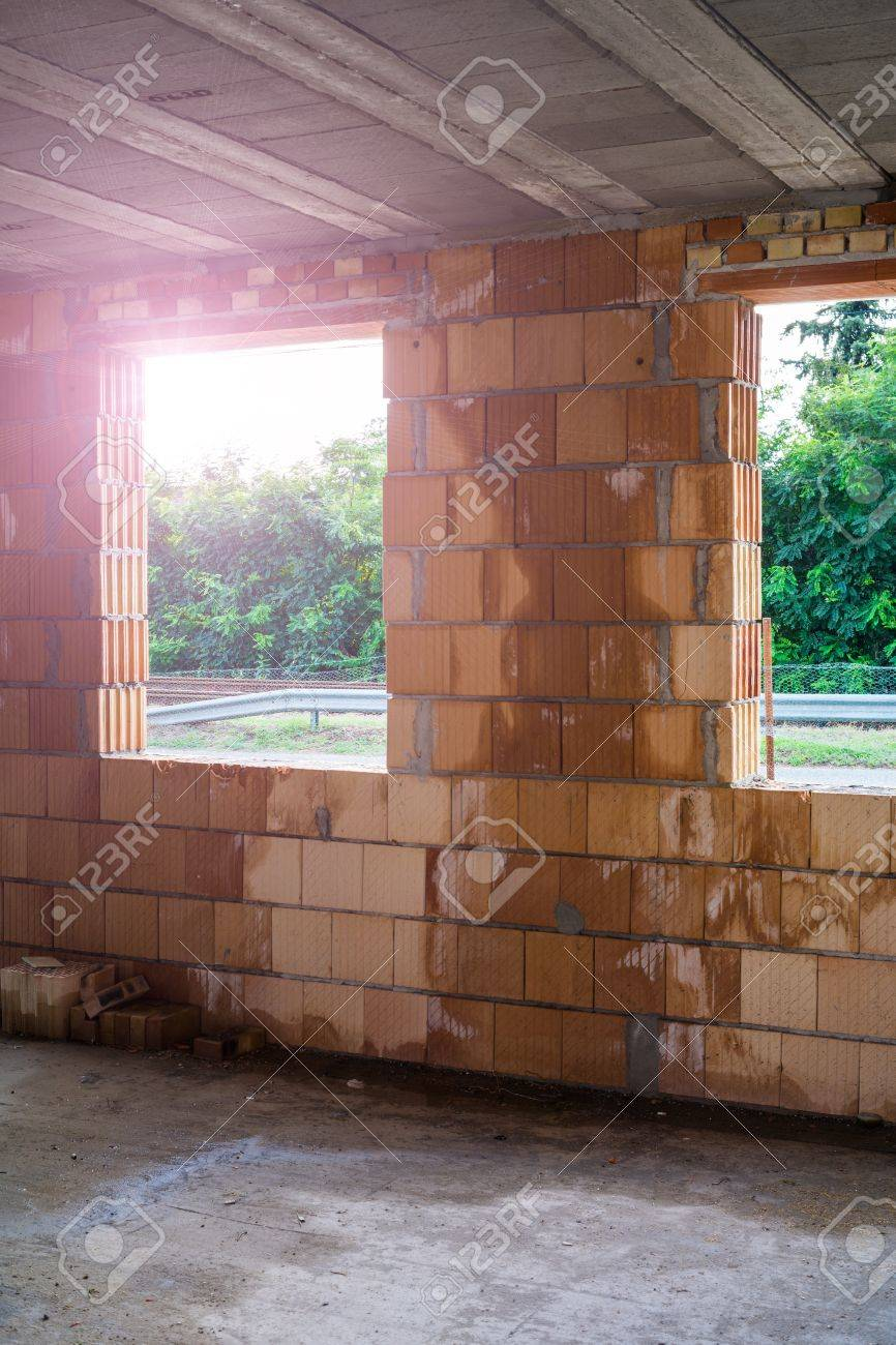 unfinished brick house interior with big windows. stock photo