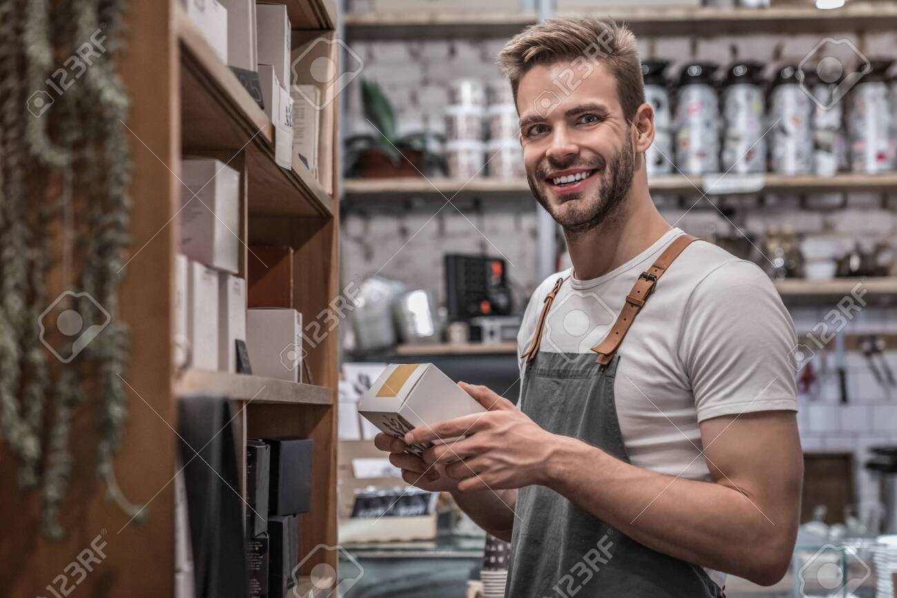 Portrait of small business owner working at his coffee shop - 138661941