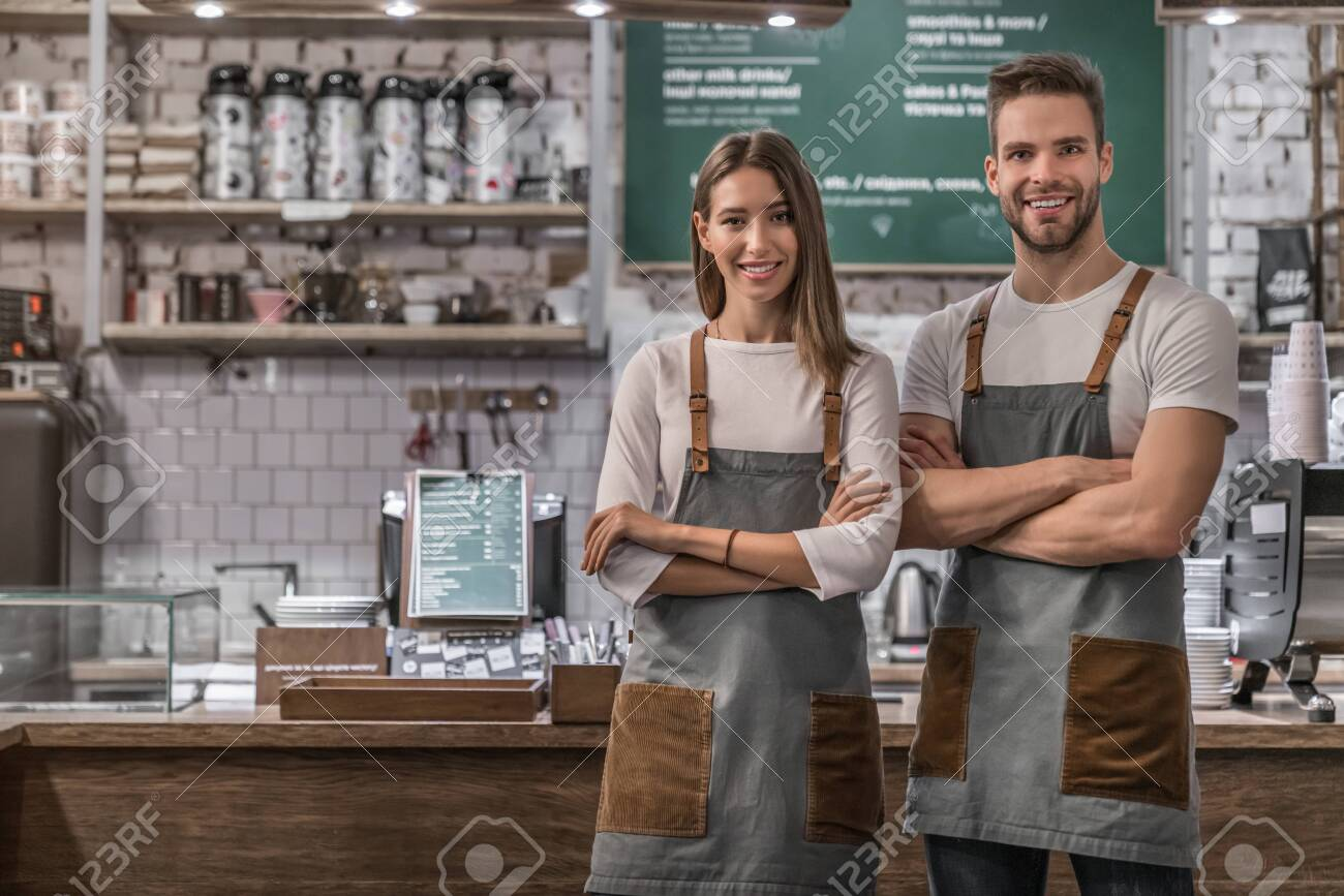 Portrait of successful business coffee shop owners - 138665522