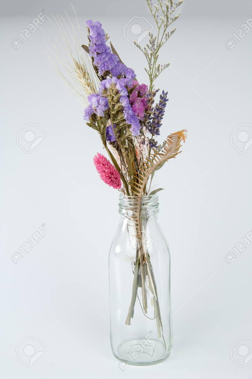 Dried Flowers In A Bottle Isolated On White Background Stock Photo