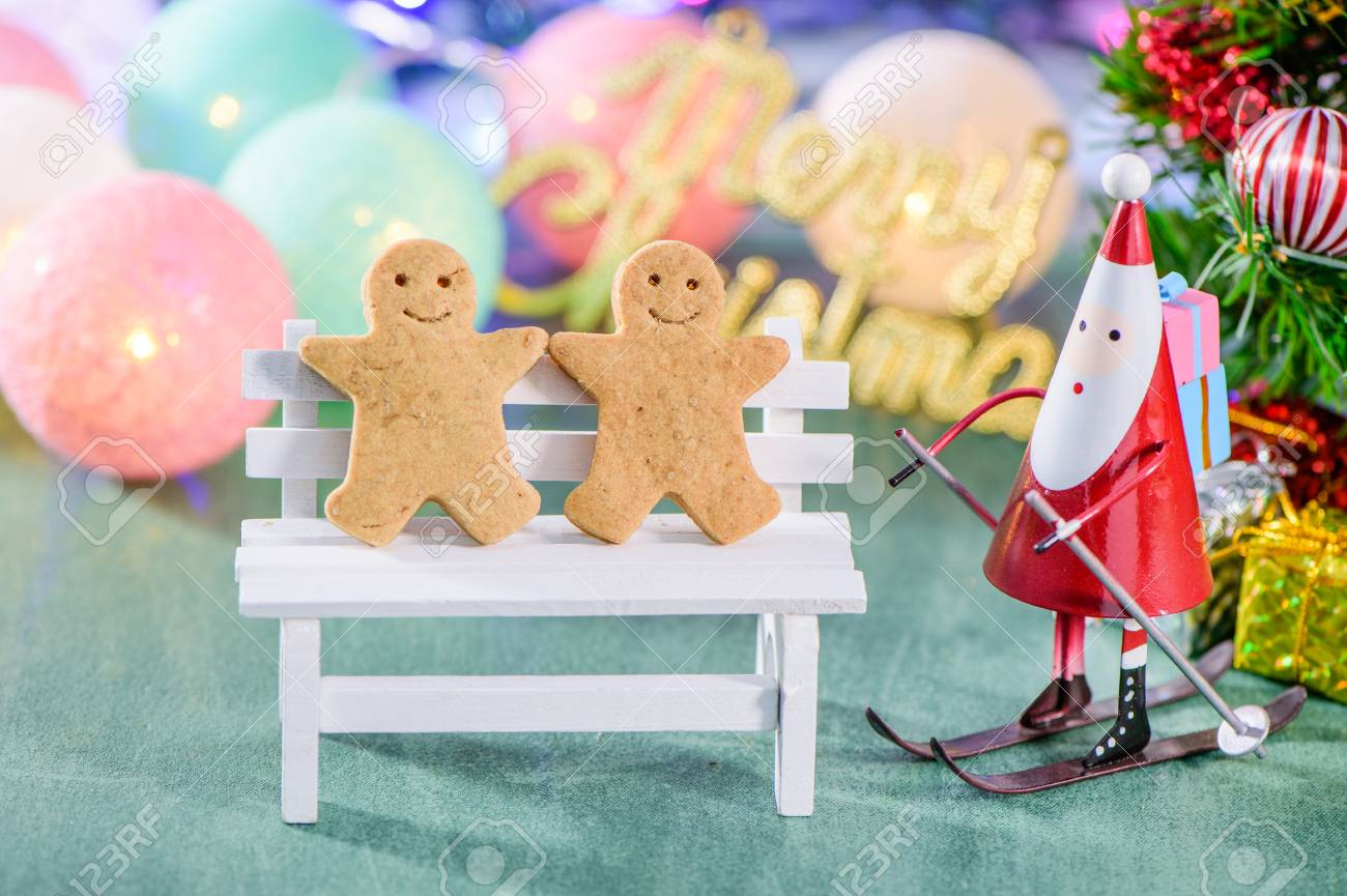 Christmas Imagery.Christmas Decoration Skating Santa Claus With Gingerbread Man
