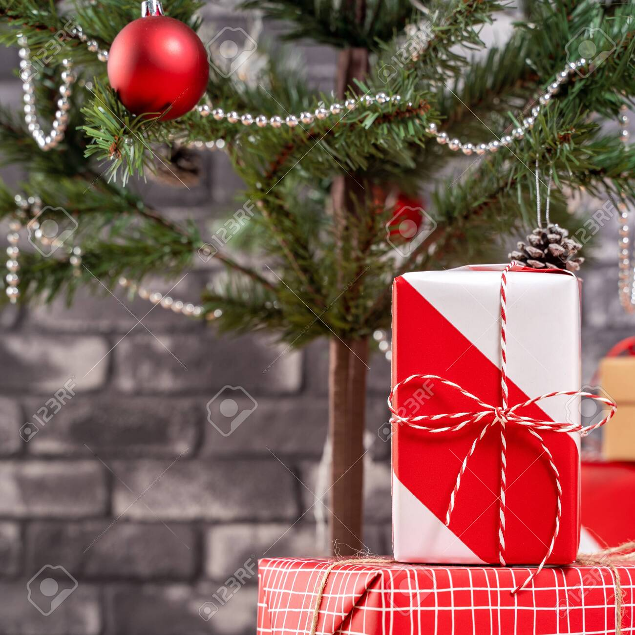 Decorated Christmas Tree With Wrapped Beautiful Red And White Stock Photo Picture And Royalty Free Image Image 153372790