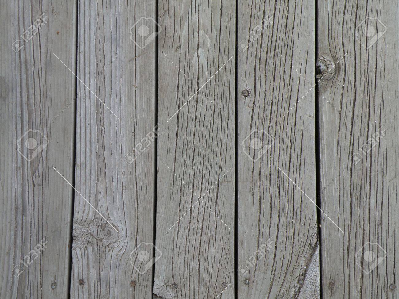 deck boards faded from the weather and sun aged pine boards stock photo