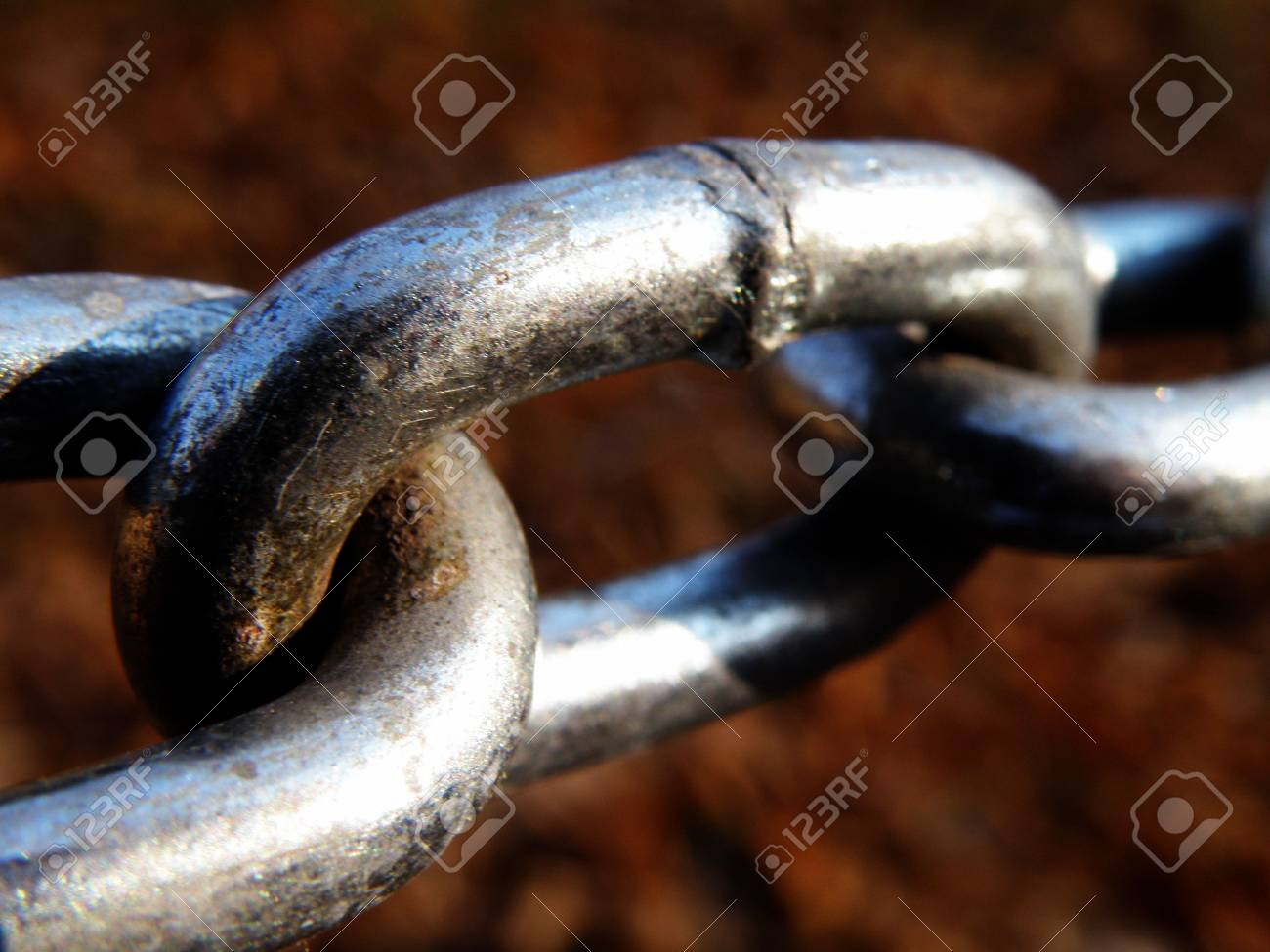 Silver links of a stretched chain. Stock Photo - 5955081