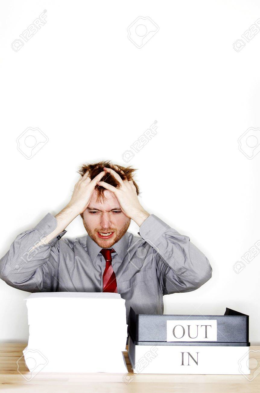 a man in office attire feeling stress out for being given too a man in office attire feeling stress out for being given too much work stock photo