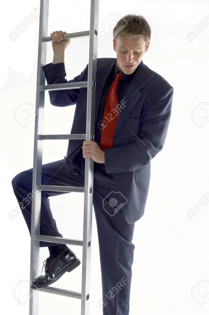 businessman looking scared climbing up the ladder stock photo businessman looking scared climbing up the ladder stock photo 26141059