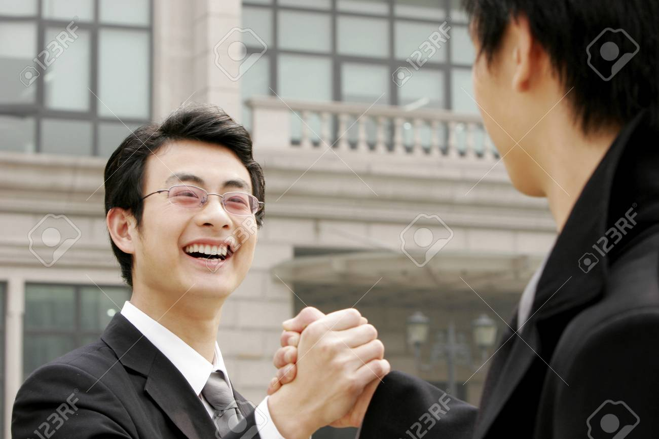 A hand grasp between two businessmen Stock Photo - 26141203