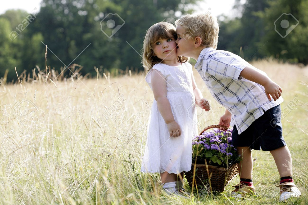 Little boy kissing little girl stock photo picture and royalty little boy kissing little girl altavistaventures Images