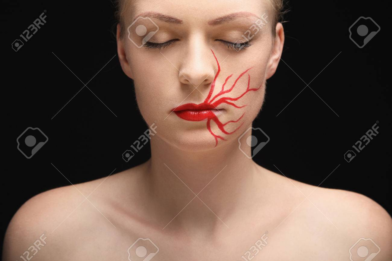 Woman With Lipstick Drawing On Her Face Closing Her Eyes