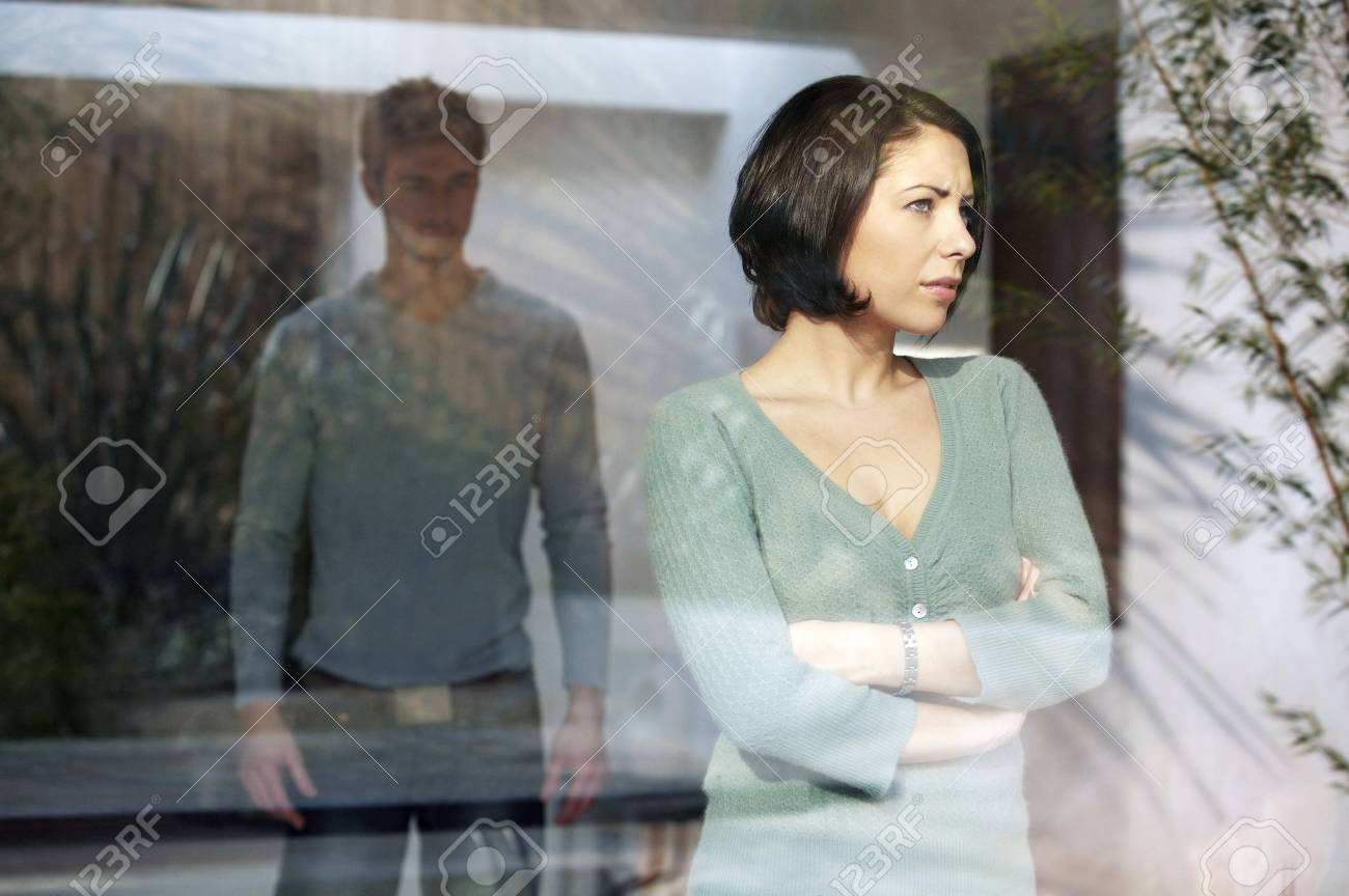 Man looking at his angry girlfriend Stock Photo - 26265871