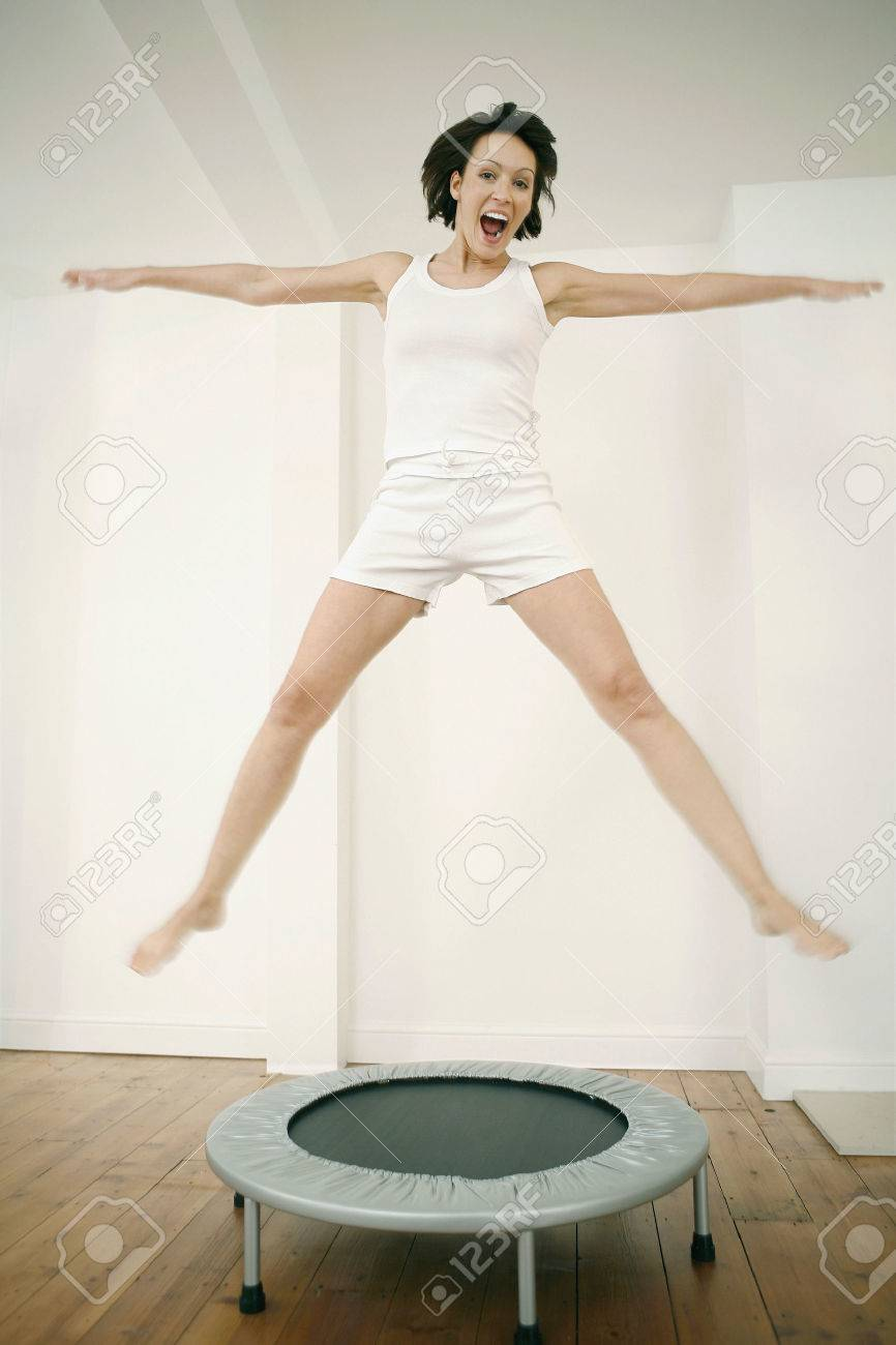 Woman jumping on a trampoline Stock Photo - 26272536