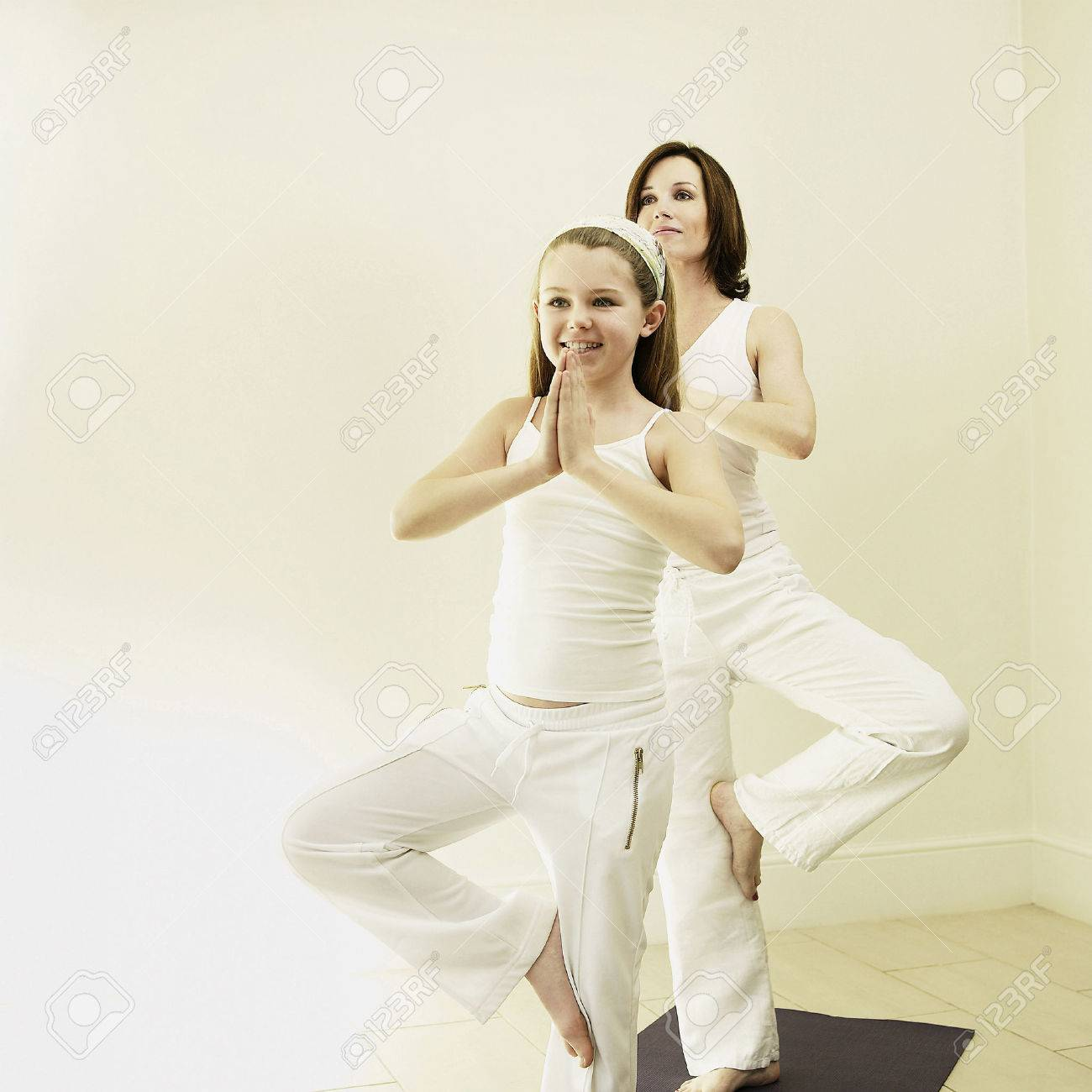 Mother and daughter practicing yoga Stock Photo - 26270524
