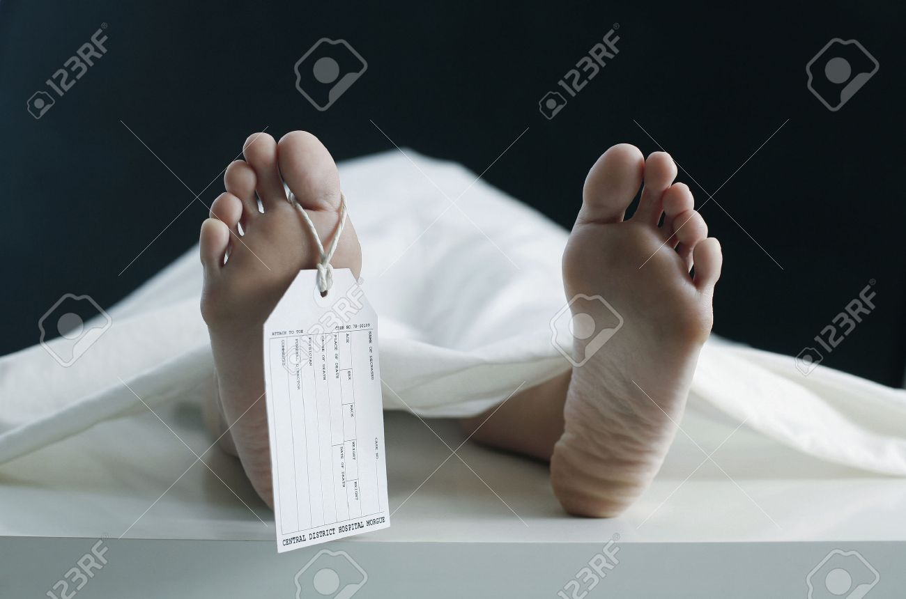 Toe tag hanging on woman lying on table in morgue Stock Photo - 26383513