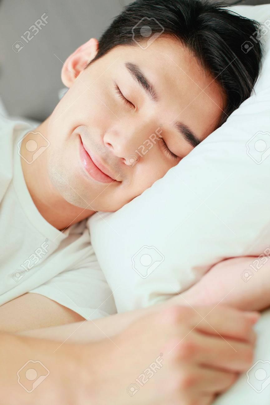Man sleeping on bed Stock Photo - 26386080
